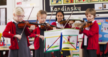 a group of children playing the violin